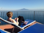 Susan knitting Strathcona overlooking Mt Vesuvius!
